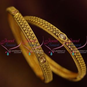 antique-gold-plated-golden-stones-broad-2-pcs-set-bangles-fancy-design-imitation-jewellery
