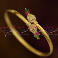 Gold Plated Twist Open Smooth Finish AD Kada Bracelets Ruby Emerald White Stones