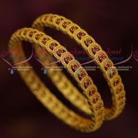 Light Delicate Gold Finish Ruby Bangles Latest Imitation Jewellery Designs Online  Width of each bangle is 7 mm Photograph is magnified and not actual size. Bangle size can be chosen using the drop down menu near add to cart button.  For daily wear, the colour life will last from 3 months to one year. For occasional wear, the colour life will last much longer To be maintained inside a plastic cover or box while unused. For more designs of similar jewellery, please visit the link here.....